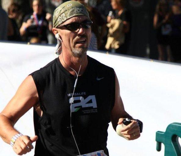 Don Ledford crosses the finish line at the Sioux Falls Marathon