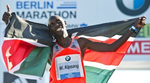 Wilson Kipsang celebrates after breaking the world marathon record.